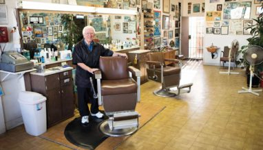 Photo of Isidoro Colonna in his Grand Avenue barber shop of San Pedro California.