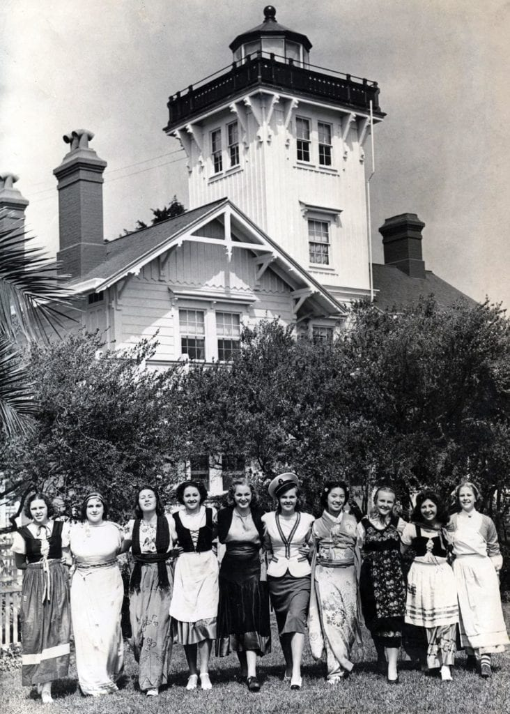 Undated photo of women in various traditional cultural dress outside Point Fermin Lighthouse. (photo: courtesy San Pedro Bay Historical Society)