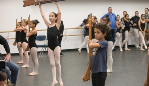 Photo of Young dancers practice with toy soldier rifles. (photo: John Mattera Photography)