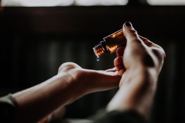 Photo hands and oil from San Pedro Today, Voices, Lori Garrett, Essential Oils (Photo by Unsplash)