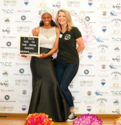 Photo of A local high school student says yes to her dress with Maria's Closet founder Ronna Luna (right) of San Pedro California. (photo: Mizzy Photography)