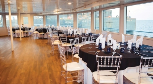 Interior photo of the yacht, The Sir Winston, includes five decks that can host up to 500 guests, four service bars, a live band and DJ dance floor, and eight restrooms. Photo by Harbor Breeze Cruises.