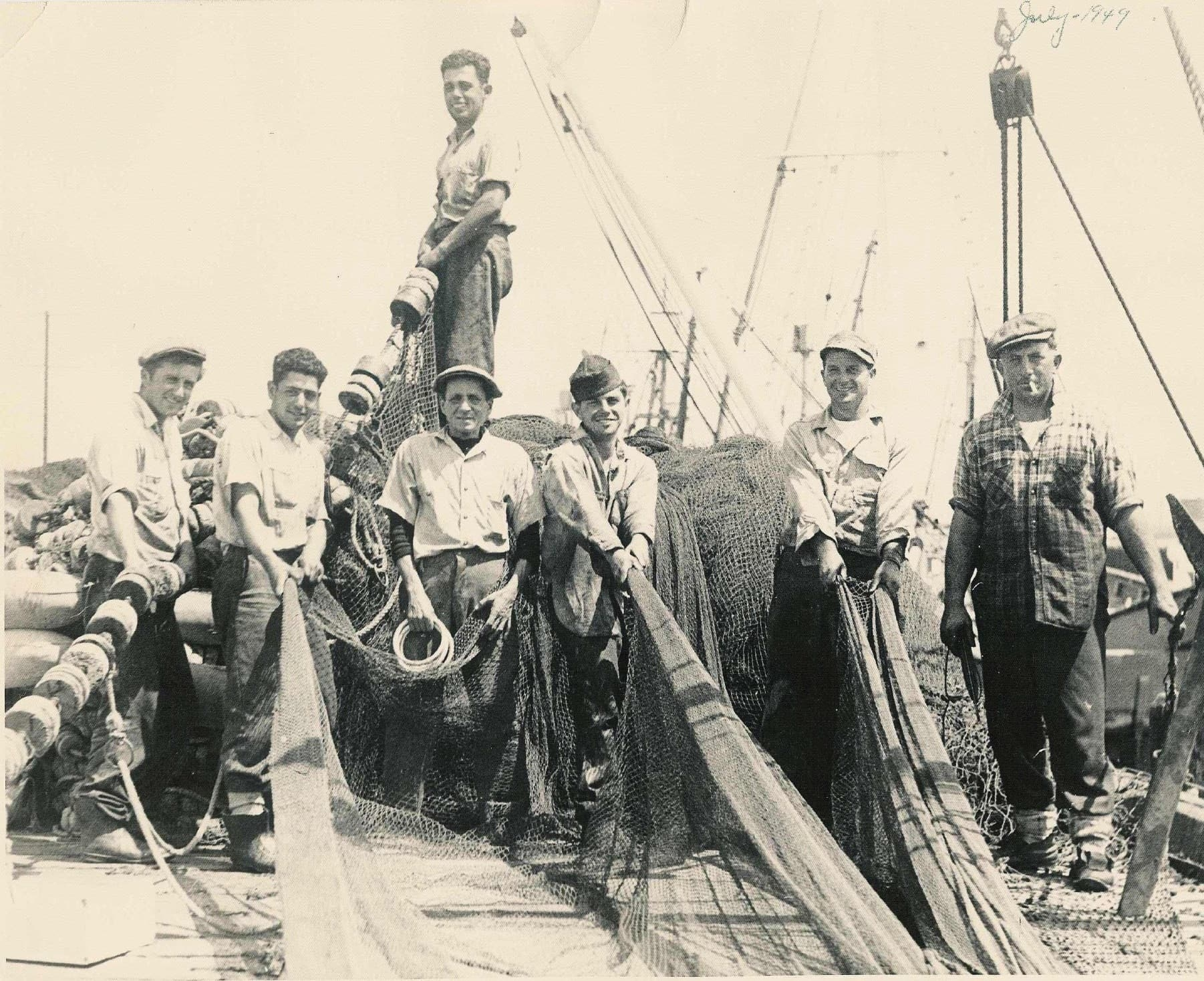"Photo of Italian American Fishermen on the San Pedro docks, July 1949. At the far left is Frank A. Iacono, one of the most successful local fisherman whose financial success would later earn him the nickname ""Captain Morgan."" (photos: courtesy Los Angeles Maritime Museum. Gift of the Iacono family)"
