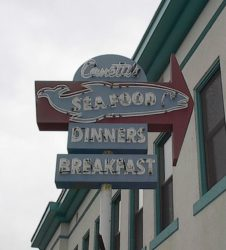 Photo of Canetti's Seafood Grotto's neon sign. (photos: courtesy Los Angeles Maritime Museum)