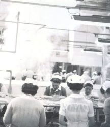 Photo of Cannery workers hard at work, the nurse uniforms were thought to convey that canned food was healthy and hygienic. (photos: courtesy Los Angeles Maritime Museum)