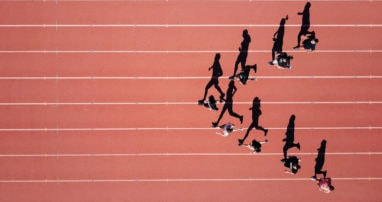 Photo of athletes running in stadium