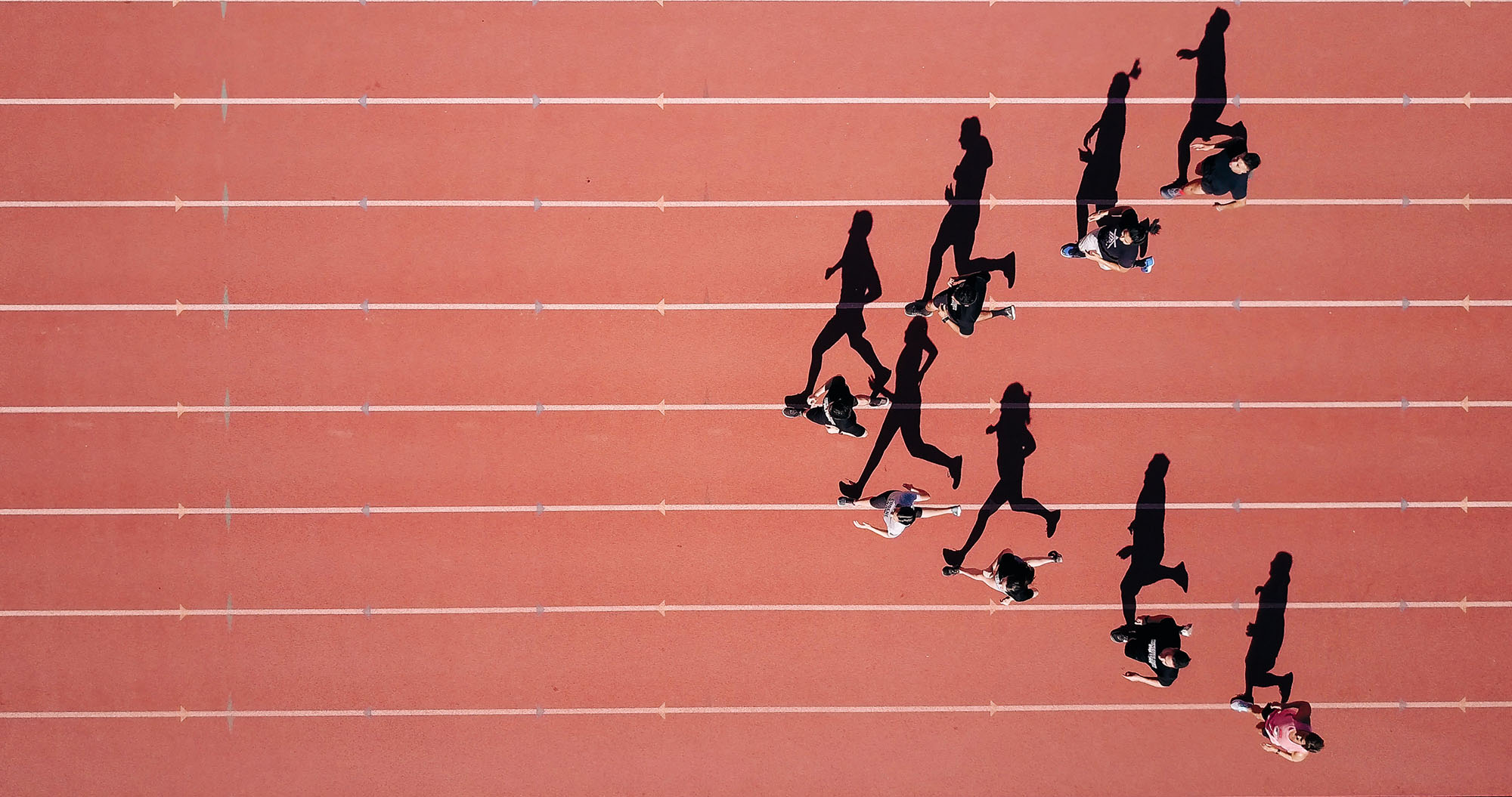 Photo of athletes running in stadium