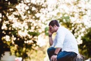 Photo of man sitting and thinking